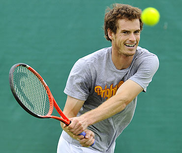 Andy Murray returns the ball during a training session on Sunday