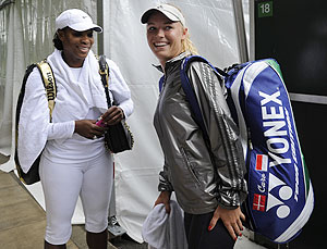 Serena Williams of the US (left) and Caroline Wozniacki of Denmark have a chat following a practice session at Wimbledon in London on Saturday