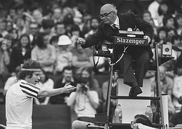 John McEnroe argues with the umpire