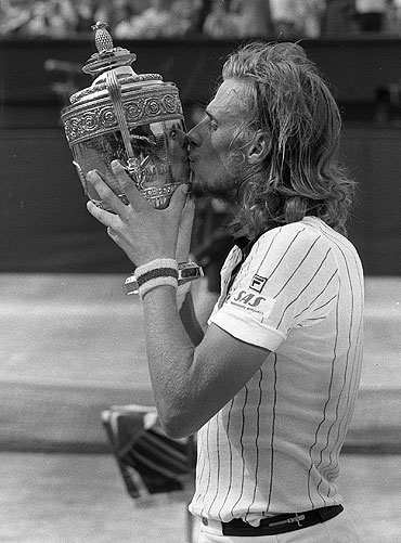 Bjorn Borg kisses the trophy after beating Ilie Nastase 6-4, 6-2, 9-7 to become Wimbledon champion in 1976