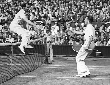 Fred Perry celebrates after winning the Wimbledon Championships in 1935