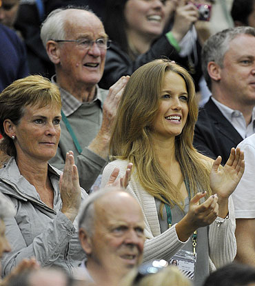 Andy Murray's mother Judy Murray (left), and his girlfriend Kim Sears (centre) applaud after the Briton defeated Daniel Gimeno-Traver