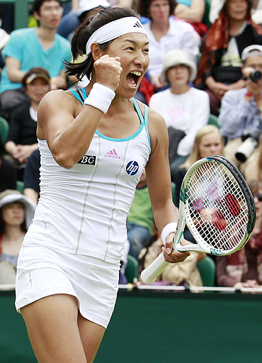 Kimiko Date-Krumm celebrates after defeating Katie O'Brien