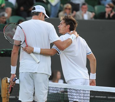 John and Mahut hug after the match