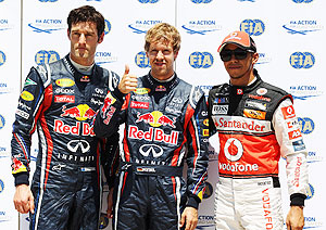 Pole sitter Sebastian Vettel (centre) second placed Mark Webber (left) and third placed Lewis Hamilton celebrate after qualifying for the European Formula One Grand Prix in Valencia, Spain on Saturday