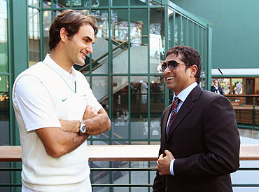 Roger Federer chats with Sachin Tendulkar on Saturday