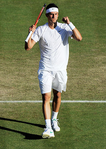 Bernard Tomic of Australia celebrates after defeating Robin Soderling on Saturday