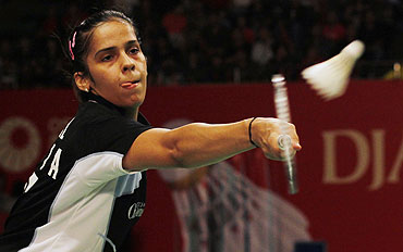 India's Saina Nehwal plays a return against Taiwan's Cheng Shao Chieh during their women's singles semi-final at the Djarum Indonesia Badminton Open Super Series Premier tournament in Jakarta on Saturday