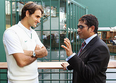 Roger Federer chats with Sachin Tendulkar at Wimbledon on Saturday