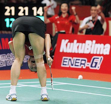 China's Wang Yihan reacts after defeating India's Saina Nehwal at the Indonesian Open Super Series in Jakarta on Sunday