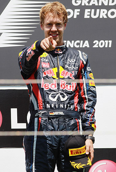 Sebastian Vettel celebrates after winning the European Formula One Grand Prix