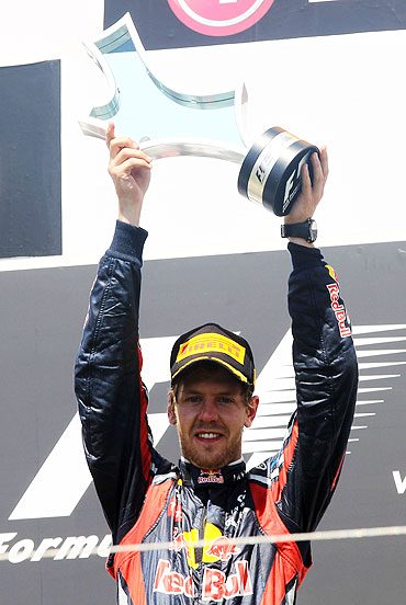 Sebastian Vettel celebrates on the podium after winning the European Formula One Grand Prix