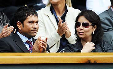 Cricketer Sachin Tendulkar and wife Anjali look on from the Royal Box during the match between Caroline Wozniacki of Denmark and Jarmila Gajdosova of Australia