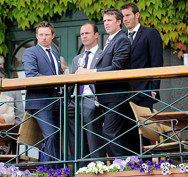 England cricketers Ian Bell (left), Jonathan Trott (centre), Graeme Swann (right) and Chris Tremlett (back) at Wimbledon
