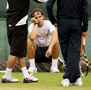 Rafael Nadal takes a break during practice on Tuesday