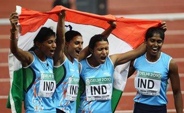 Ashwini, Manjeet Kaur, Mandeep Kaur and Sini Jose after winning the gold at the Commonwealth Games