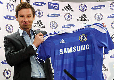Andre Villas-Boas holds a shirt as he is unveiled as the new Chelsea manager