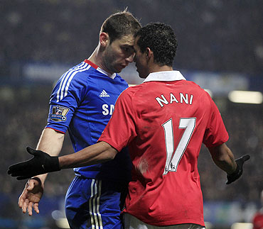 Manchester United's Nani (right) and Chelsea's Branislav Ivanovic get aggressive with each other