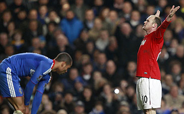 Manchester United's Wayne Rooney (right) celebrates after scoring as Chelsea's Ashley Cole reacts