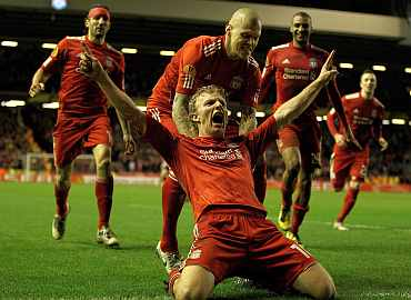 Dirk Kuyt celebrates after scoring