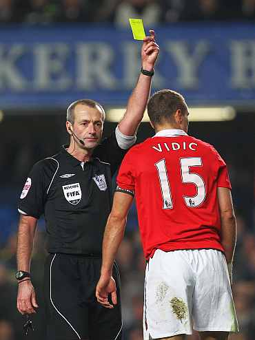 Man United's Vidic gets a yellow card