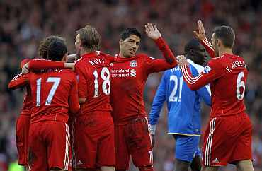 Liverpool players celebrate after scoring a goal