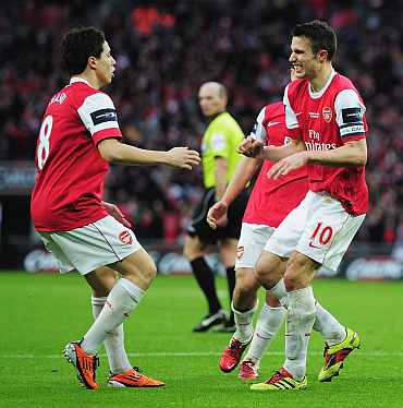 Van Persie colebrates after scoring a goal