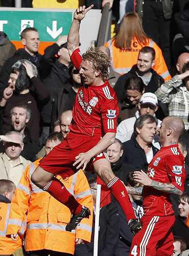 Liverpool's Dirk Kuyt (left) celebrates scoring his second goal against Manchester United on Sunday