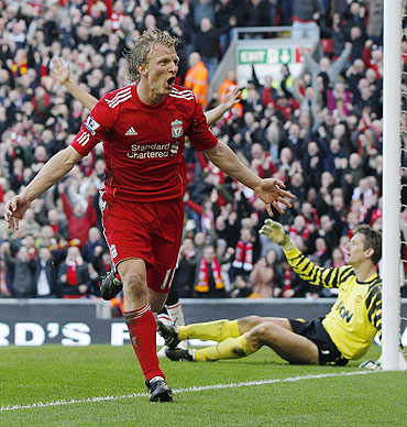 Liverpool's Dirk Kuyt (left) celebrates his third goal against Manchester United