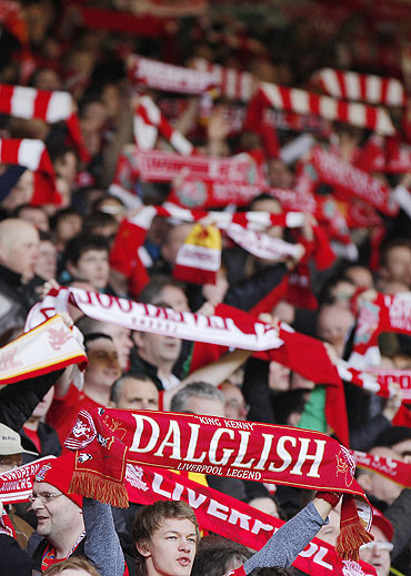 Liverpool supporters hold up scarves and sing Happy Birthday for Daglish