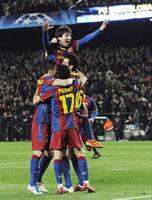 Barcelona's Lionel Messi (centre) celebrates with teammates after scoring his second goal