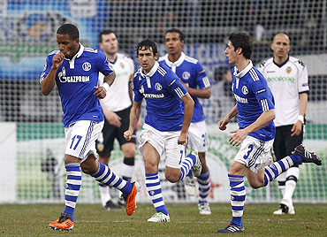Jefferson Farfan (left) of Schalke 04 sucks his thumb as he celebrates his goal against Valencia on Wednesday