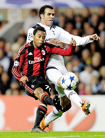 Robinho (left) of AC Milan and Tottenham's Sandro vie for possession