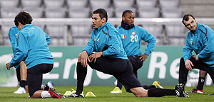 Inter Miln players warm up during a training session in Munich on Monday