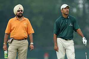 Jeev (right) and coach Amritinder Singh