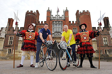 Sebastian Coe and Michael Day pose for the camera at Hampton Court Palace as th new route for the Olympic Games Cycling Time Trial was announced on Thursday