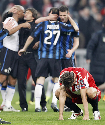 Bayern Munich's Mario Gomez (right) reacts after losing to Inter Milan in Munich on Tuesday