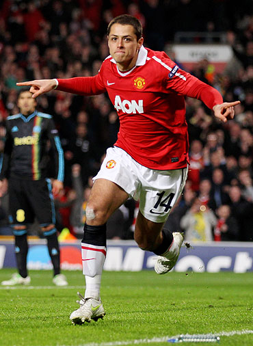 Javier Hernandez of Manchester United celebrates scoring the opening goal