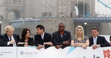 (from left to right) Boris Johnson, the Mayor of London, former gymnast Nadia Comaneci, Lord Sebastian Coe, former track and field athlete Carl Lewis, swimmer Rebecca Adlington and Sports Minister Hugh Robertson attend a photocall to officially launch the sale of tickets for the London 2012 Olympic Games