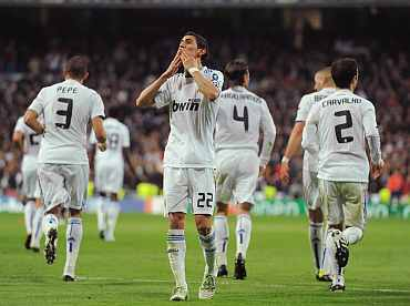 Real Madrid's Di Maria celebrates after scoring against Lyon during their Champions League match