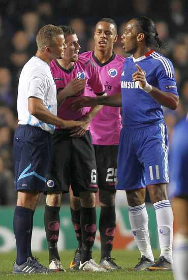 Chelsea's Dider Drogba argues with referee during the Champions League match