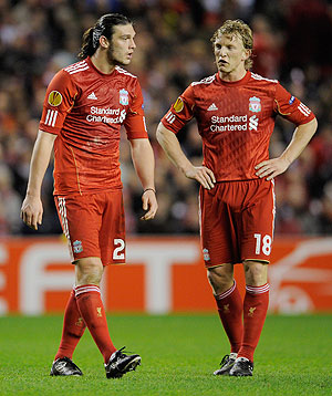 Liverpool's Dirk Kuyt (right) and Andy Carroll put on a dejected look after being knocked out of the UEFA Europa League Round of 16 second leg match against SC Braga