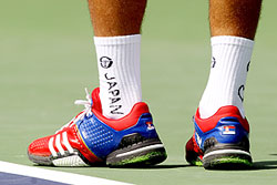 Tribute to Japan writen on Novak Djokovic's socks