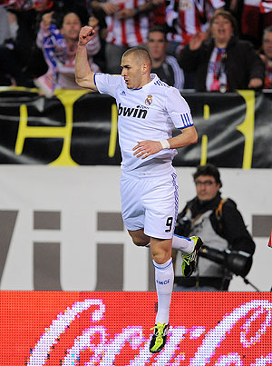 Karim Benzema of Real Madrid celebrates after scoring the opening goal against Atletico Madrid on Saturday