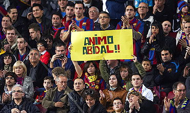 Barcelona fans display a banner in support of Eric Abidal before the match against Getafe on Saturday