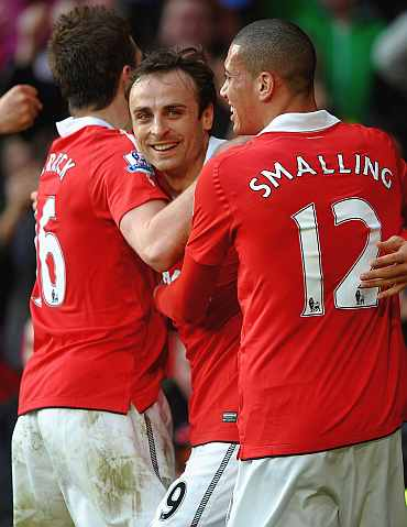 Manchester United's Dimitar Berbatov celebrates after scoring against Bolton