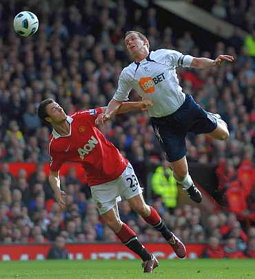 Jonny Evans battles with Kevin Davies of Bolton Wanderers during their EPL match