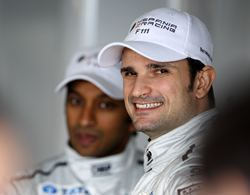 Hispania Racing drivers Vitantonio Liuzzi of Italy (R) and Narain Karthikeyan of India (L)