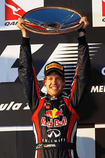 Red Bull's Sebastian Vettel celebrates after winning the Australian GP at the Albert Park Circuit