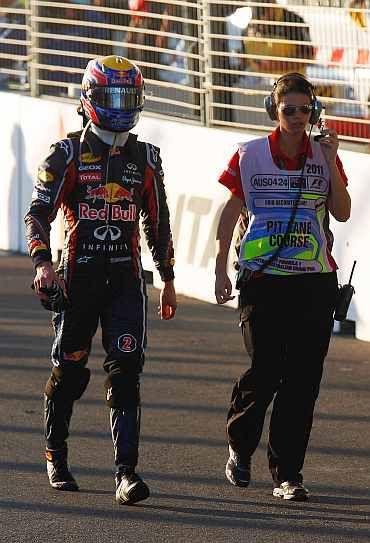 Mark Webber walks back to the paddock area after the Australian Grand Prix